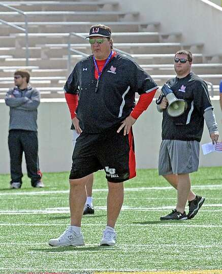 Coach Ray Woodard over looks practice during the Lamar University football scrimmage at Provost-Umph
