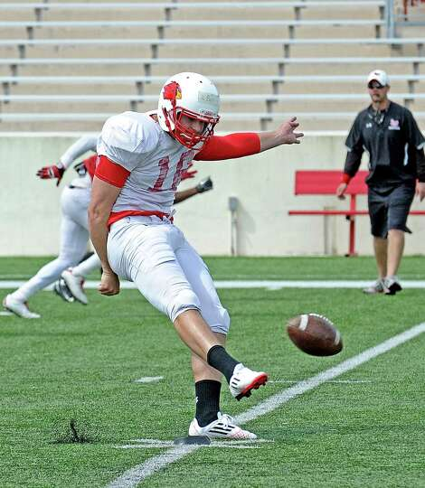 Kicker Pat McGriff, #16, works on his kickoff routine during the Lamar University football scrimmage