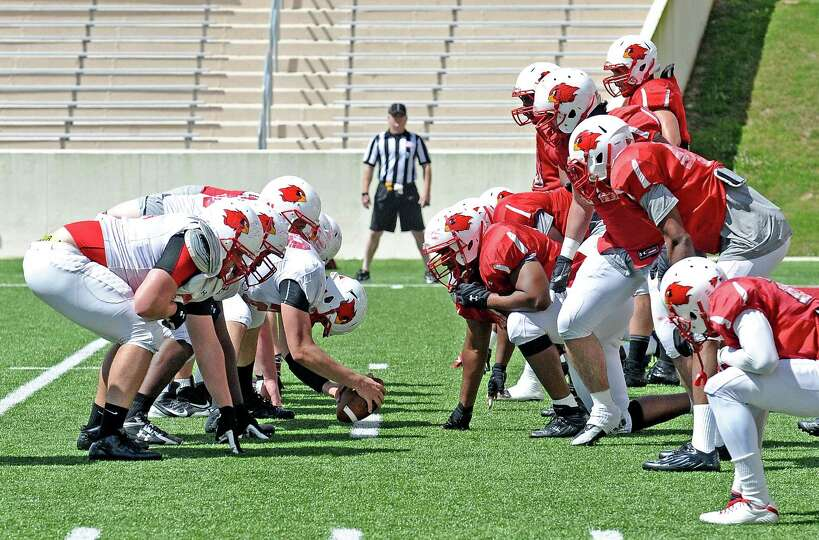 Lamar offense and defense line up during the Lamar University football scrimmage at Provost-Umphrey