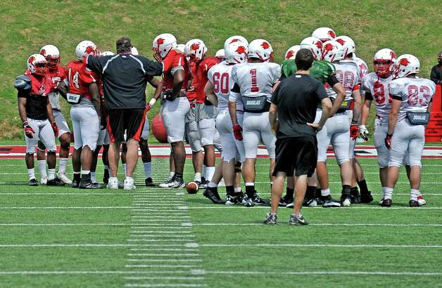 Coach Ray Woodard talks to the defense during the Lamar University football scrimmage at Provost-Umphrey Stadium on Saturday, April 13, 2013. Photo taken: Randy Edwards/The Enterprise