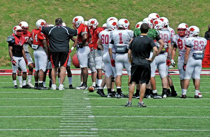 Coach Ray Woodard talks to the defense during the Lamar University football scrimmage at Provost-Ump
