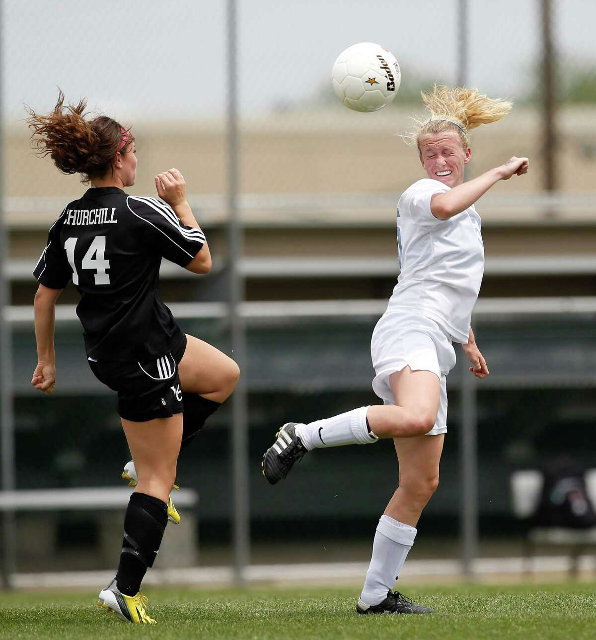 Johnson's Madelyn Carter, right, heads the ball as Churchill's Rachel Gurinsky defends during game action of the Region IV-5A girls final at the North East Soccer Stadium on Saturday, April 13, 2013. MICHAEL MILLER / FOR THE EXPRESS-NEWS