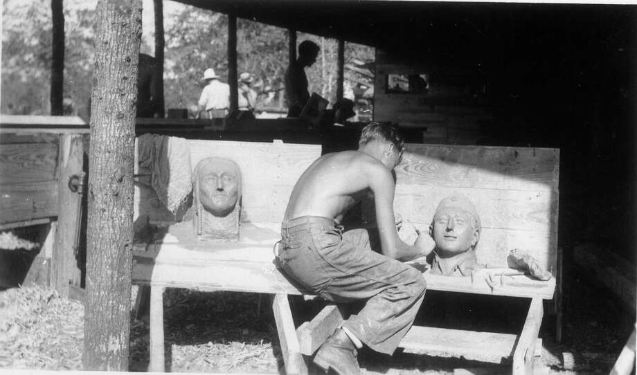 James Taylor of the Civilian Conservation Corps creates a bust in 1937. The corps nurtured the talents of members, teaching trades and skills. Photo: Texas Parks And Wildlife Departm / Texas Parks and Wildlife Departm