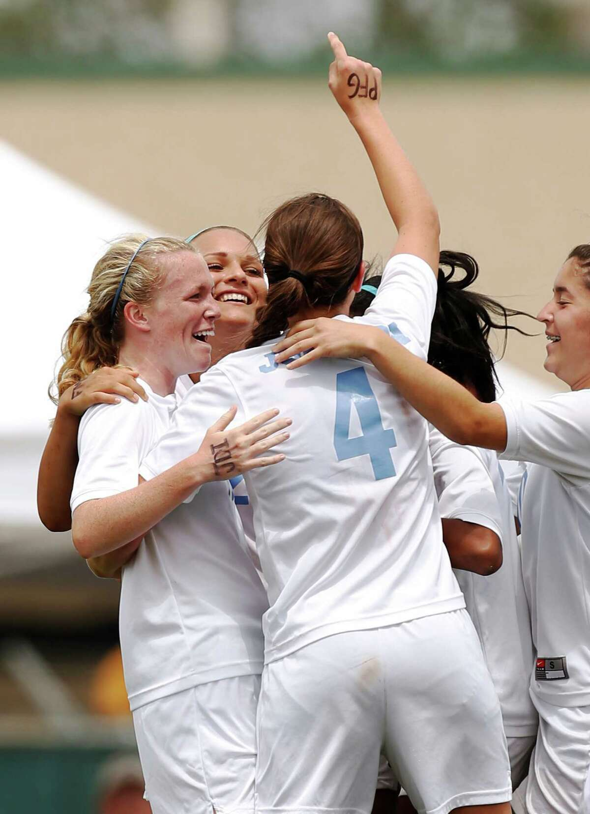Johnson players celebrate after Madelyn Carter scored during game action of the Region IV-5A girls final against Churchill at the North East Soccer Stadium on Saturday, April 13, 2013. MICHAEL MILLER / FOR THE EXPRESS-NEWS