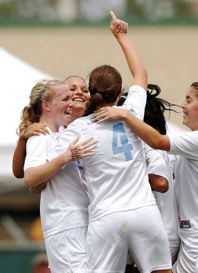 Johnson players celebrate after Madelyn Carter scored during game action of the Region IV-5A girls final against Churchill at the North East Soccer Stadium on Saturday, April 13, 2013. MICHAEL MILLER / FOR THE EXPRESS-NEWS Photo: Michael Miller, Express-News / For the Express-News