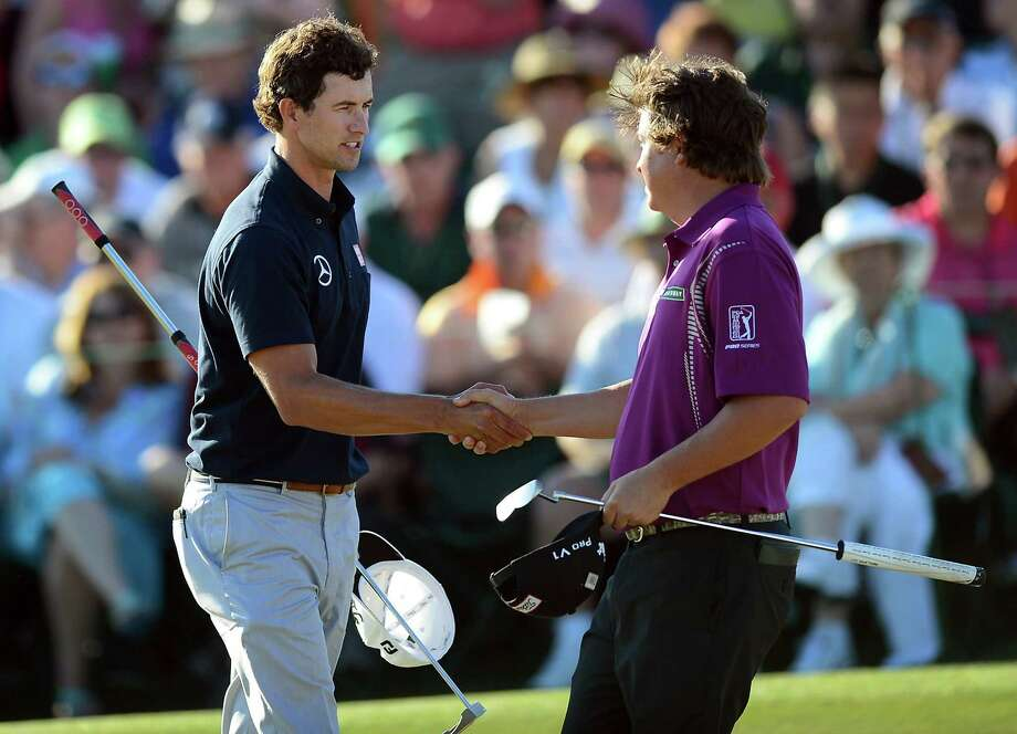 Adam Scott, left, shakes hands with golfer Jason Dufner, following their third round in the Masters at the Augusta National Golf Club in Augusta, Georgia, Saturday, April 13, 2013. (Jeff Siner/Charlotte Observer/MCT) Photo: Jeff Siner, McClatchy-Tribune News Service / Charlotte Observer