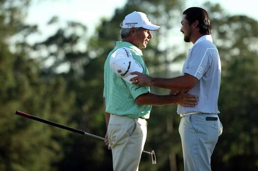 AUGUSTA, GA - APRIL 13:  Fred Couples (L) of the United States shakes hands with Jason Day of Australia after completing the third round of the 2013 Masters Tournament at Augusta National Golf Club on April 13, 2013 in Augusta, Georgia. Photo: Andrew Redington, Getty Images / 2013 Getty Images