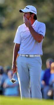 Jason Day reacts to missing his par putt on the 17th green during the third round of the Masters at Augusta National Golf Club in Augusta, Georgia, Saturday, April 13, 2013. (Curtis Compton/Atlanta Journal-Constitution/MCT) Photo: Curtis Compton, McClatchy-Tribune News Service / Atlanta Journal-Constitution