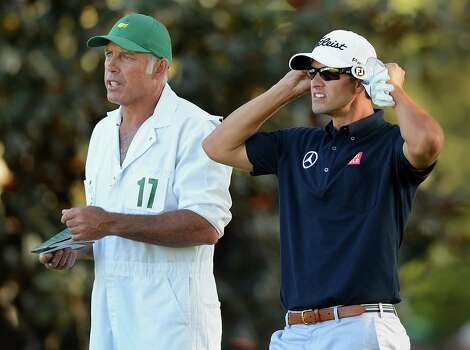 Adam Scott, right, waits with his caddie, Steve Williams prior to hitting from the 18th fairway during third-round action in the Masters at the Augusta National Golf Club in Augusta, Georgia, Saturday, April 13, 2013. (Jeff Siner/Charlotte Observer/MCT) Photo: Jeff Siner, McClatchy-Tribune News Service / Charlotte Observer