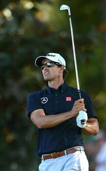 Adam Scott watches the flight of his ball to the 18th green during third-round action in the Masters at the Augusta National Golf Club in Augusta, Georgia, Saturday, April 13, 2013. (Jeff Siner/Charlotte Observer/MCT) Photo: Jeff Siner, McClatchy-Tribune News Service / Charlotte Observer