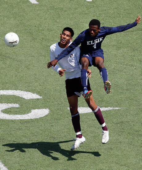 Deer Park's Rudy Rodriguez, left, defends against a leaping Gafar Dauda of Elsik in the first half of their Class 5A Region III soccer final Saturday. Photo: Cody Duty, Staff / © 2013 Houston Chronicle