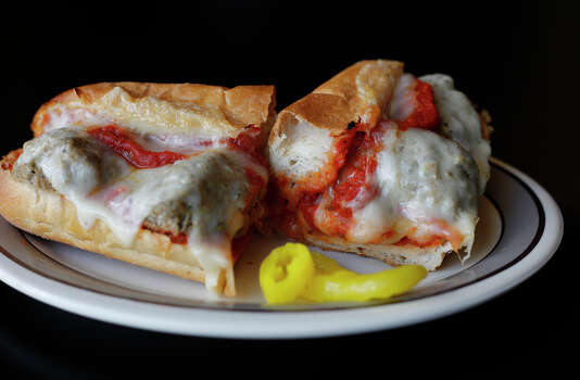 Review of Deco Pizzeria on Tuesday, June 28, 2011. Featured dishes: Chicken wings, hero sub, meatball sub (pictured), fruit pizza and sangria. Kin Man Hui/kmhui@express-news.net Photo: KIN MAN HUI, San Antonio Express-News / San Antonio Express-News