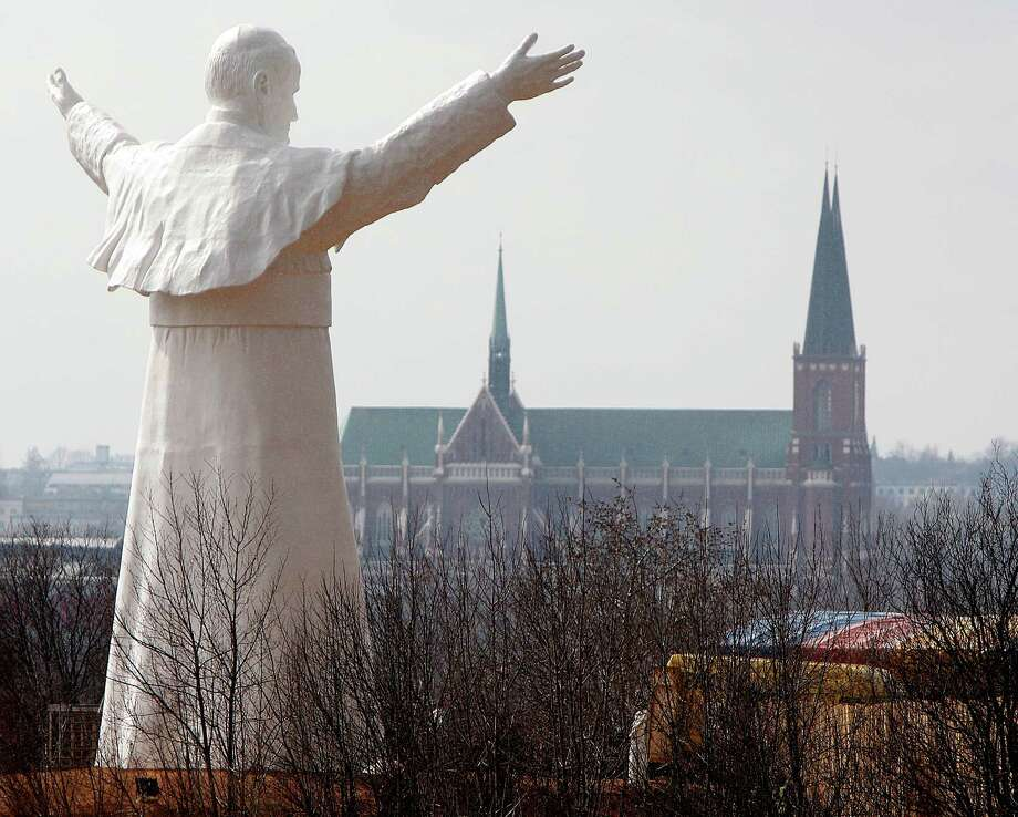 The sculpture of the late Pope John Paul II was unveiled Saturday in Czestochowa, Poland. Photo: Czarek Sokolowski, STF / AP