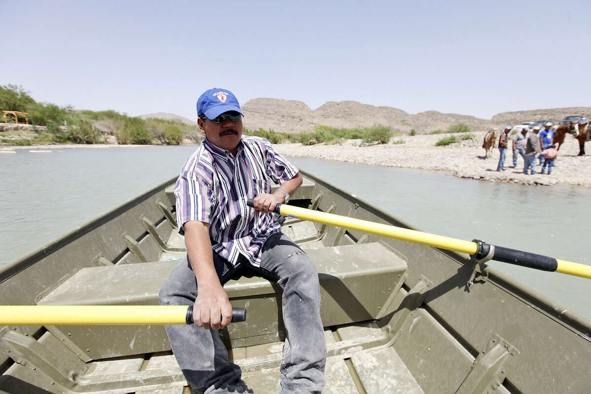 Adrian Valdez Cabello rows a boat across the Rio Grande from Boquillas del Carmen, Mexico, to Big Bend National Park on the American side of the river.