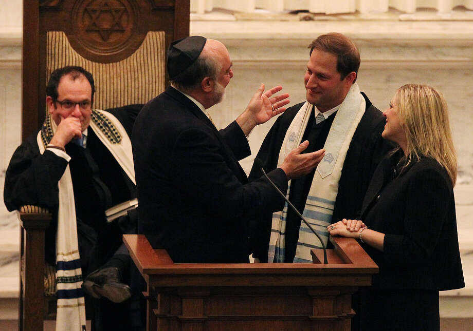 Rabbi Barry Block (from left) watches as Rabbi David Ellenson, president of the Hebrew Union College-Jewish Institute of Religion, offers his blessings to Rabbi Ari Plost and his wife, Star Trompeter. Photo: Kin Man Hui / San Antonio Express-News
