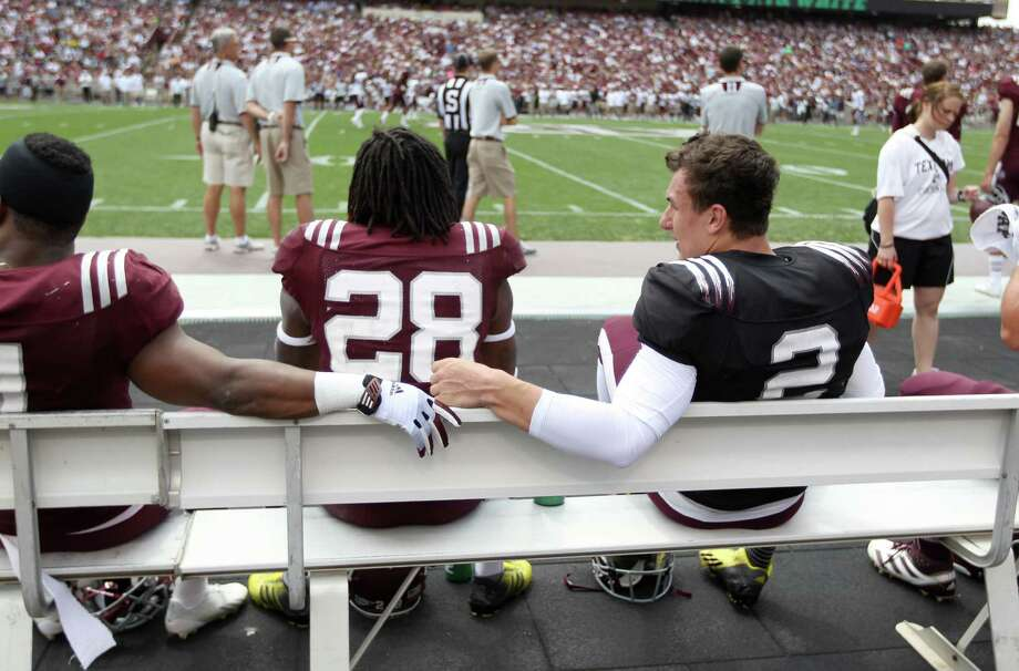 Texas A&M Aggies quarterback Johnny Manziel (2) sits on the bench during the first half of the Texas A&M University's Maroon & White, spring game at Kyle Field, Saturday, April 13, 2013, in College Station. Photo: Karen Warren, Houston Chronicle / © 2013 Houston Chronicle
