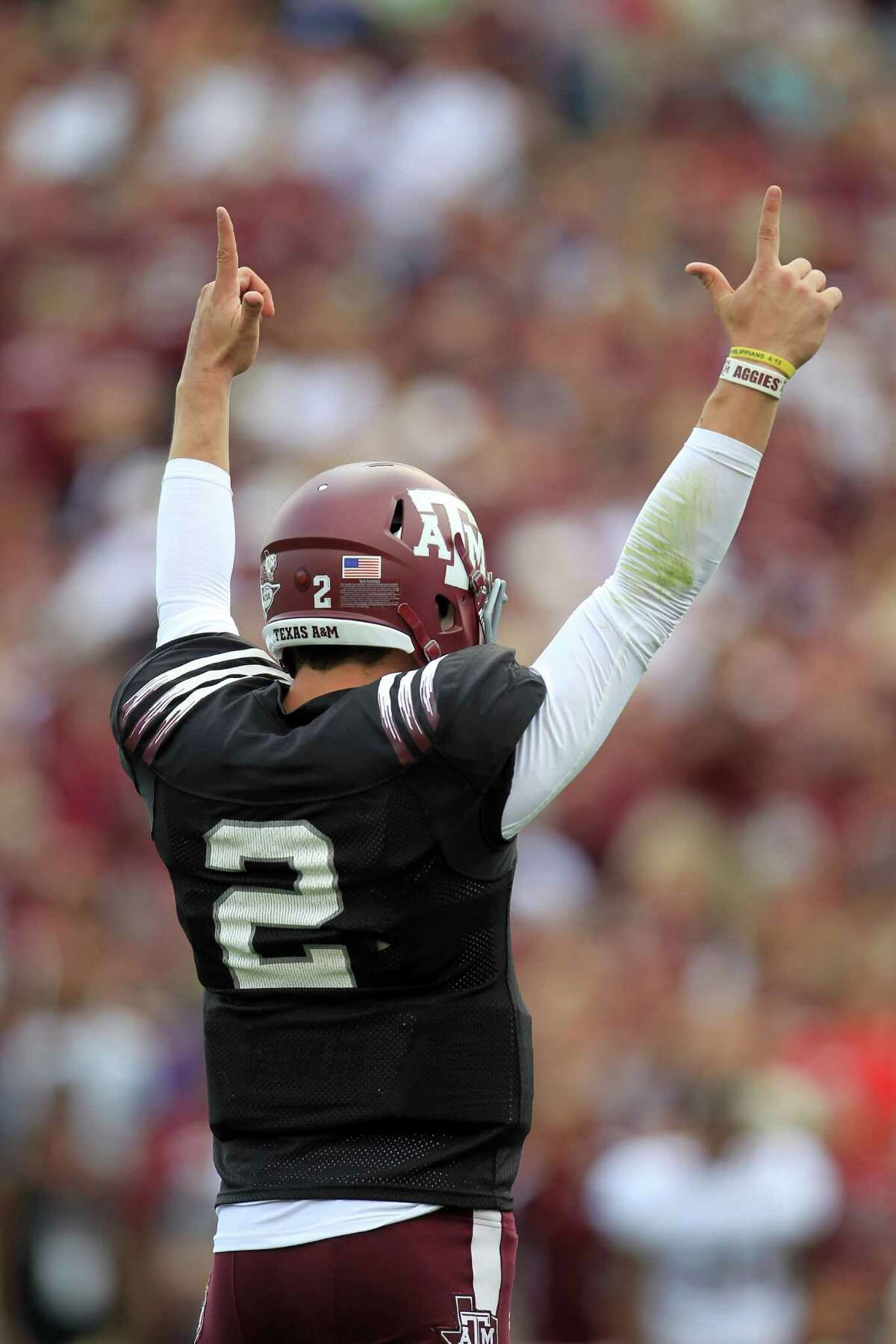 Texas A&M Aggies quarterback Johnny Manziel (2) reacts after a touchdown during the first half of the Texas A&M University's Maroon & White, spring game at Kyle Field, Saturday, April 13, 2013, in College Station.