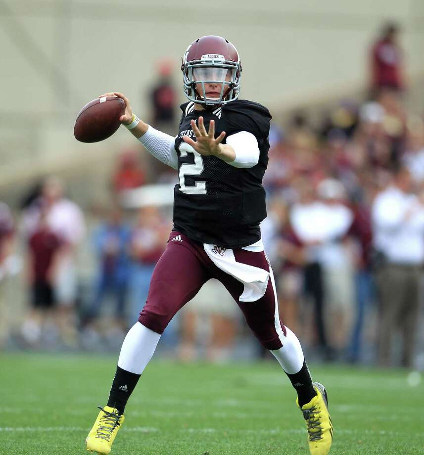 Texas A&M Aggies quarterback Johnny Manziel (2) throws during the first half of the Texas A&M University's Maroon & White, spring game at Kyle Field, Saturday, April 13, 2013, in College Station. Photo: Karen Warren, Houston Chronicle / © 2013 Houston Chronicle