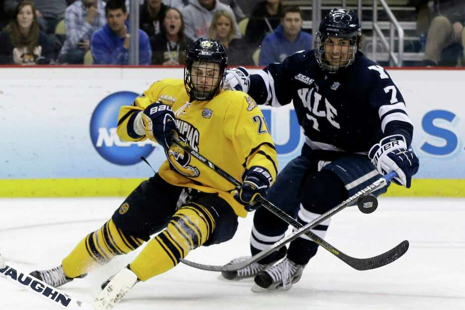 Quinnipiac's Matthew Peca (20) and Yale's Matt Killian (7) go after a rebound during the first period of the NCAA men's college hockey national championship game in Pittsburgh Saturday, April 13, 2013. (AP Photo/Gene Puskar) Photo: Gene Puskar, Associated Press / AP