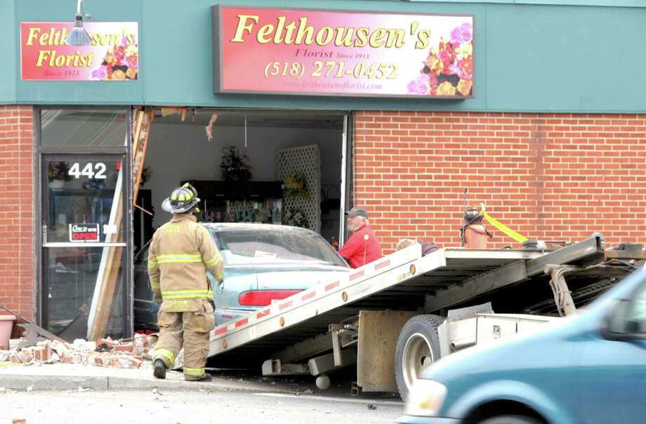A Troy man smashed his car into Felthousen's Florist on Hoosick Street Saturday afternoon. The driver, Robert Toles of Fifth Avenue, was charged by Troy police for unsafe driving. (Brian Houle/Special to the Times Union)