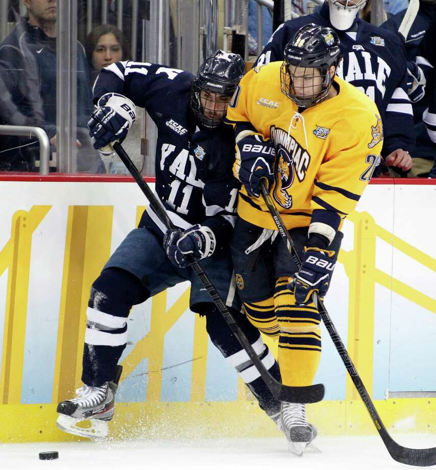 PITTSBURGH, PA - APRIL 13:  Trent Ruffolo #11 of the Yale Bulldogs and Matthew Peca #20 of the Quinnipiac Bobcats battle for a puck during the game at Consol Energy Center on April 13, 2013 in Pittsburgh, Pennsylvania.  (Photo by Justin K. Aller/Getty Images) Photo: Justin K. Aller, Getty Images / 2013 Getty Images