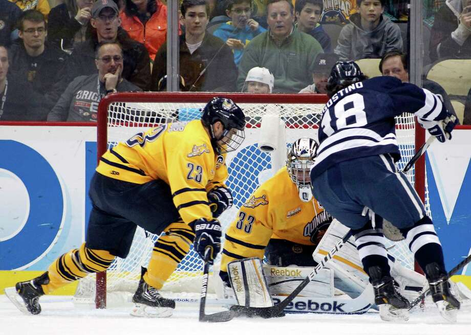 PITTSBURGH, PA - APRIL 13:  Eric Hartzell #33 of the Quinnipiac Bobcats makes a save against the Yale Bulldogs during the game at Consol Energy Center on April 13, 2013 in Pittsburgh, Pennsylvania.  (Photo by Justin K. Aller/Getty Images) Photo: Justin K. Aller, Getty Images / 2013 Getty Images