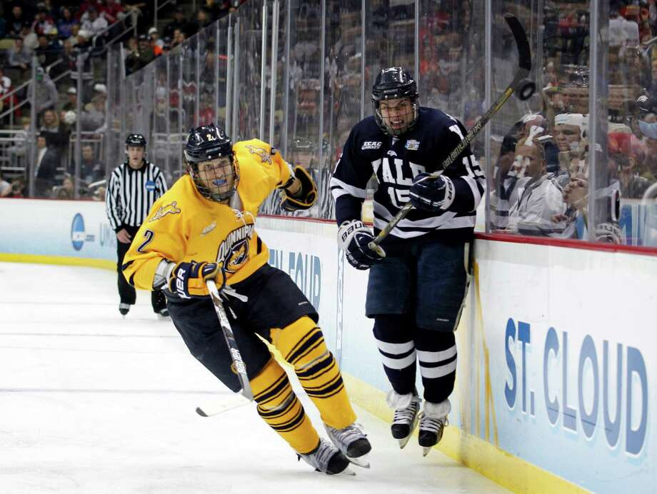 PITTSBURGH, PA - APRIL 13:  Clinton Bourbonais #15 of the Yale Bulldogs skates against Mike Dalhuisen #2 of the Quinnipiac Bobcats during the game at Consol Energy Center on April 13, 2013 in Pittsburgh, Pennsylvania.  (Photo by Justin K. Aller/Getty Images) Photo: Justin K. Aller, Getty Images / 2013 Getty Images