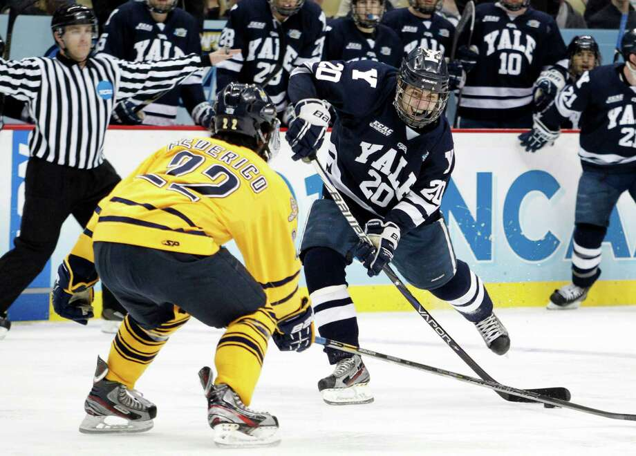 PITTSBURGH, PA - APRIL 13:  Jesse Root #20 of the Yale Bulldogs takes a shot against the Quinnipiac Bobcats during the game at Consol Energy Center on April 13, 2013 in Pittsburgh, Pennsylvania.  (Photo by Justin K. Aller/Getty Images) Photo: Justin K. Aller, Getty Images / 2013 Getty Images