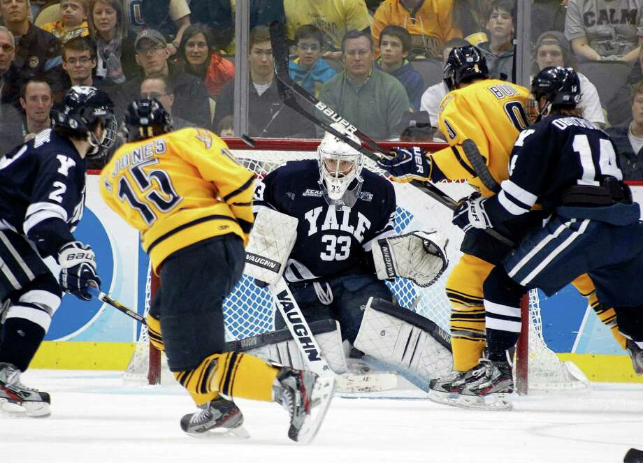 PITTSBURGH, PA - APRIL 13:  Jeff Malcolm #33 of the Yale Bulldogs makes a save against the Quinnipiac Bobcats during the game at Consol Energy Center on April 13, 2013 in Pittsburgh, Pennsylvania.  (Photo by Justin K. Aller/Getty Images) Photo: Justin K. Aller, Getty Images / 2013 Getty Images