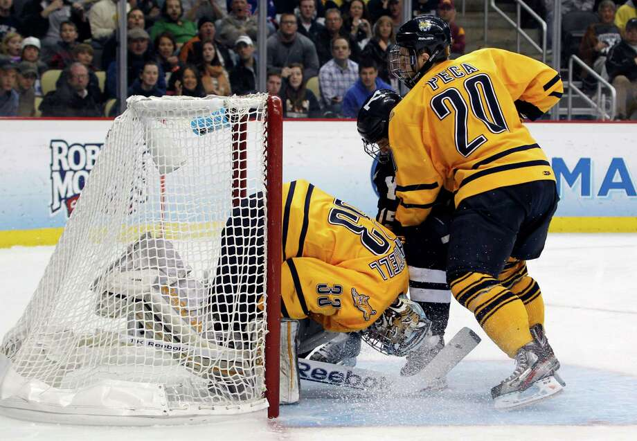 PITTSBURGH, PA - APRIL 13:  Clinton Bourbonais #15 of the Yale Bulldogs crashes the net against Eric Hartzell #33 of the Quinnipiac Bobcats during the game at Consol Energy Center on April 13, 2013 in Pittsburgh, Pennsylvania.  (Photo by Justin K. Aller/Getty Images) Photo: Justin K. Aller, Getty Images / 2013 Getty Images