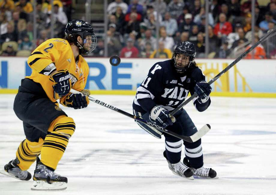PITTSBURGH, PA - APRIL 13:  Trent Ruffolo #11 of the Yale Bulldogs skates against Mike Dalhuisen #2 of the Quinnipiac Bobcats during the game at Consol Energy Center on April 13, 2013 in Pittsburgh, Pennsylvania.  (Photo by Justin K. Aller/Getty Images) Photo: Justin K. Aller, Getty Images / 2013 Getty Images