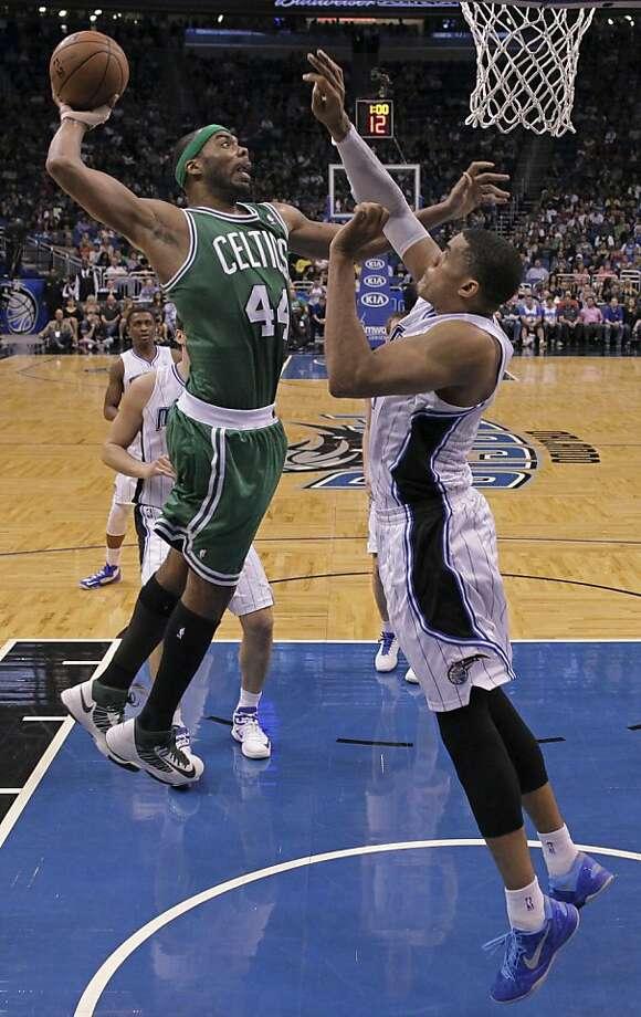 Celtics forward Chris Wilcox dunks over the Magic's Tobias Harris during the second half. Photo: John Raoux, Associated Press