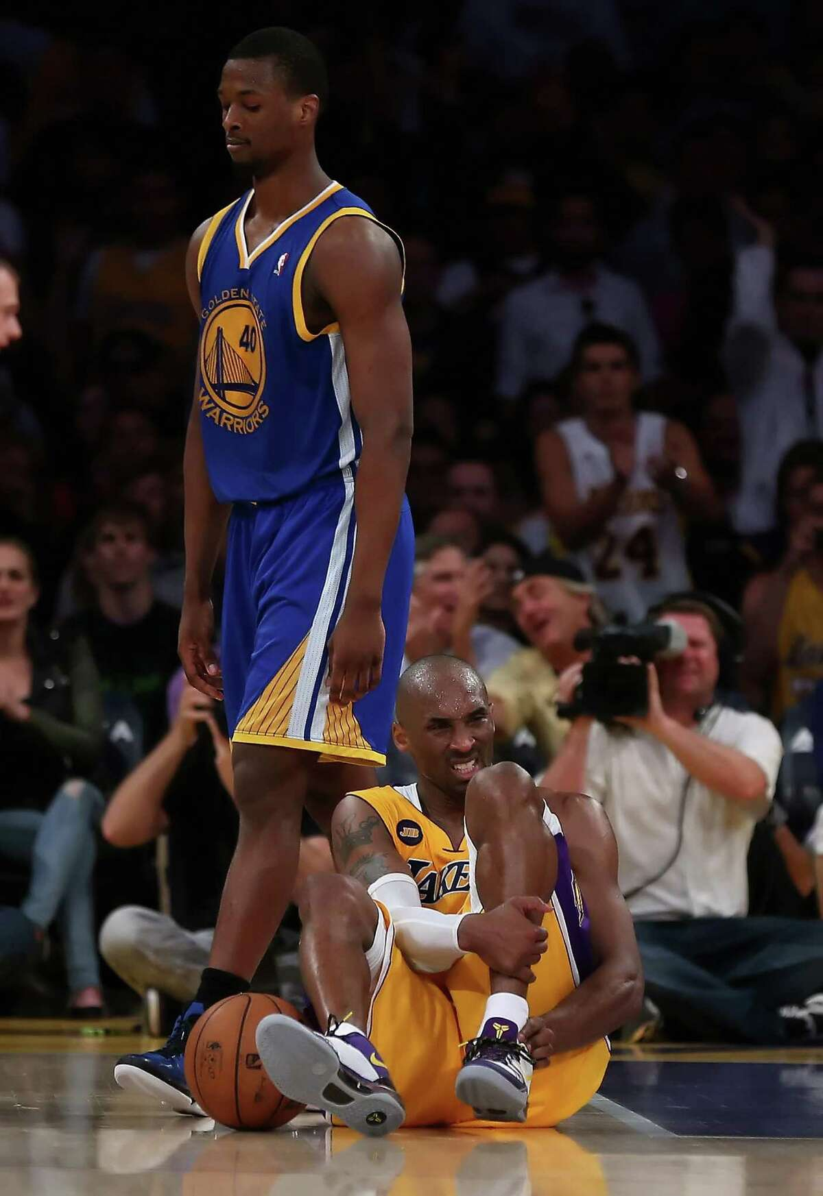 Kobe Bryant's season ended after he suffered a torn Achilles tendon in Friday's game against Golden State.
