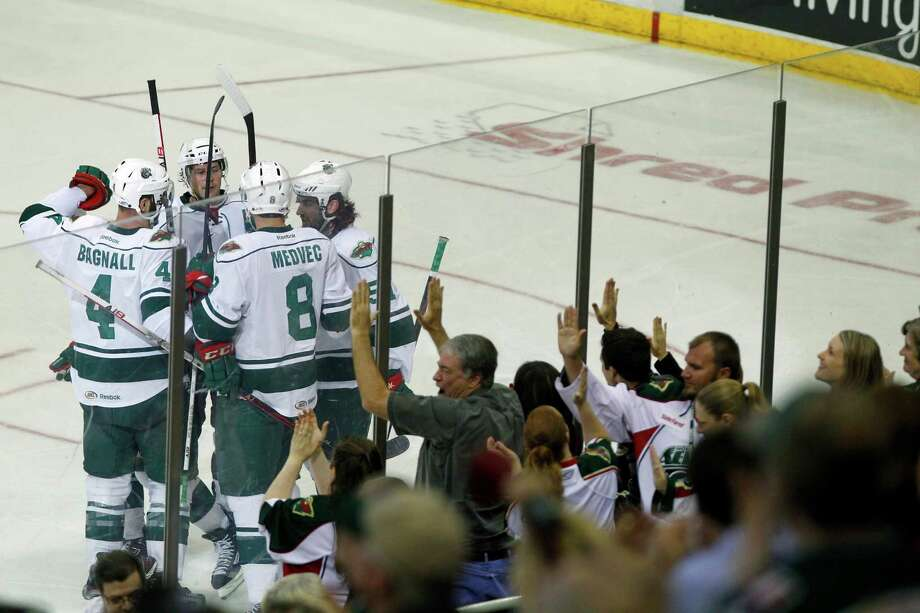 The Houston Aeros celebrate a goal agains the San Antonio Rampage during the second period of the Aeros final regular-season game at the Toyota Center Saturday, April 13, 2013, in Houston. Photo: Cody Duty, Houston Chronicle / © 2013 Houston Chronicle
