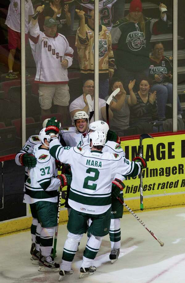 The Houston Aeros celebrate after Justin Fontaine scored a goal against the San Antonio Rampage during the first period of the Aeros final regular-season game at the Toyota Center Saturday, April 13, 2013, in Houston. Photo: Cody Duty, Houston Chronicle / © 2013 Houston Chronicle