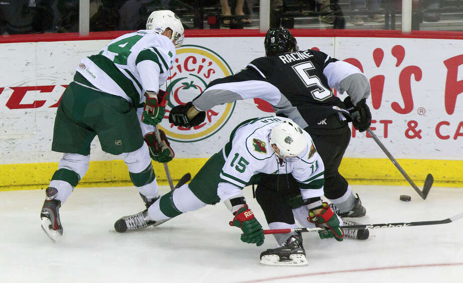 Houston Aeros left wing Stephane Veilleux, left, and Erik Haula, center, get tangled with San Antonio Rampage defenseman Jonathan Racine during the first period of the Aeros final regular-season game at the Toyota Center Saturday, April 13, 2013, in Houston. Photo: Cody Duty, Houston Chronicle / © 2013 Houston Chronicle