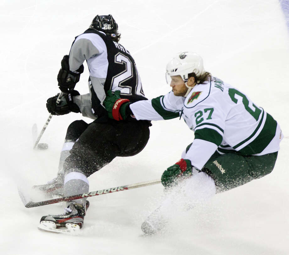 San Antonio Rampage right wing Jon Rheault, left, skates past Houston Aeros center Carson McMillan, right, during the first period of the Aeros final regular-season game at the Toyota Center Saturday, April 13, 2013, in Houston. Photo: Cody Duty, Houston Chronicle / © 2013 Houston Chronicle