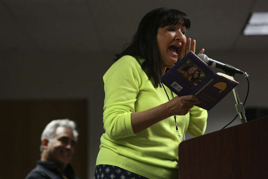 "Sandra Cisneros reads from her book ""Have You Seen Marie?"" as moderator John Phillip Santos watches during the Texas Book Festival/San Antonio Edition at the Central Library. Photo: Lisa Krantz / San Antonio Express-News"