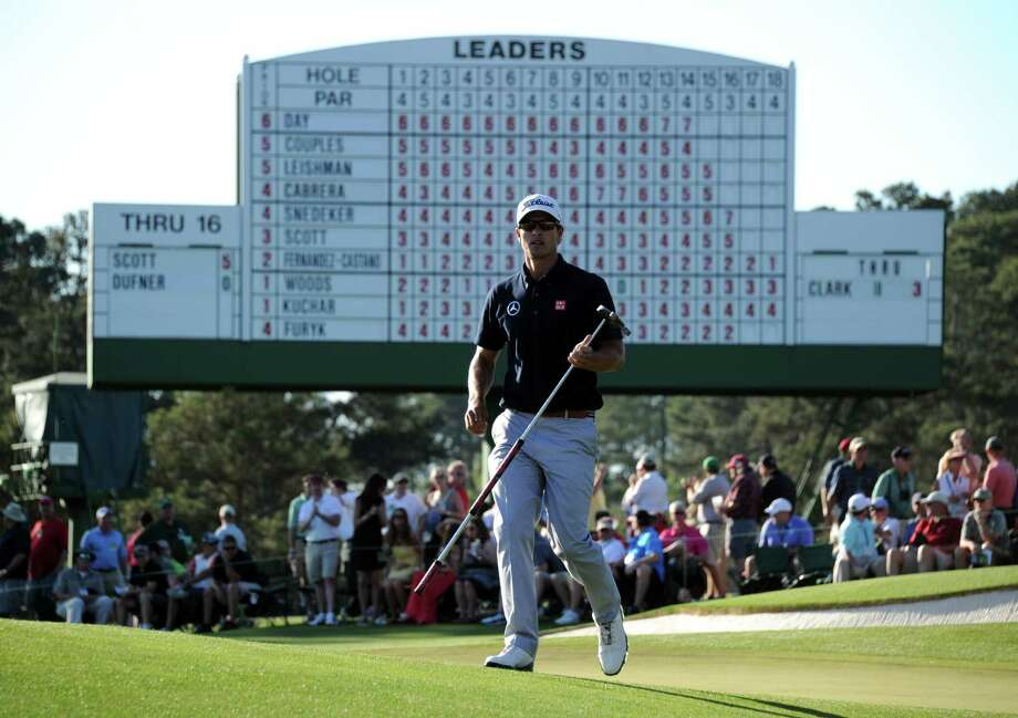 Adam Scott of Australia plays during the third round of the 77th Masters golf tournament at Augusta National Golf Club on April 13, 2013 in Augusta, Georgia.  AFP PHOTO / JIM WATSONJIM WATSON/AFP/Getty Images Photo: JIM WATSON
