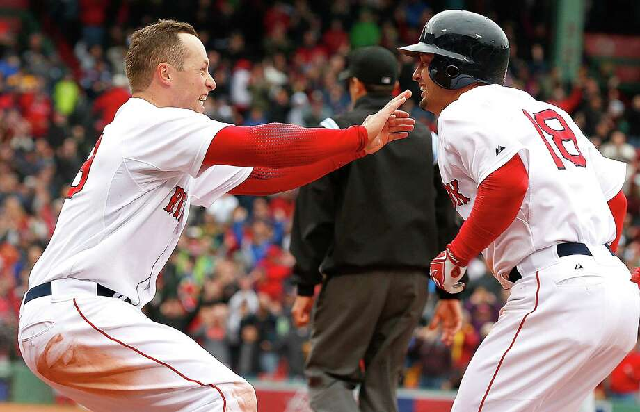 BOSTON, MA - APRIL 13:  Shane Victorino #18 of the Boston Red Sox, with helmet celebrates with Greg Colbrunn #28 of the Boston Red Sox after Victorino singled in the winning run in the 10th inning against the Tampa Bay Rays at Fenway Park on April 13, 2013 in Boston, Massachusetts.  (Photo by Jim Rogash/Getty Images) Photo: Jim Rogash
