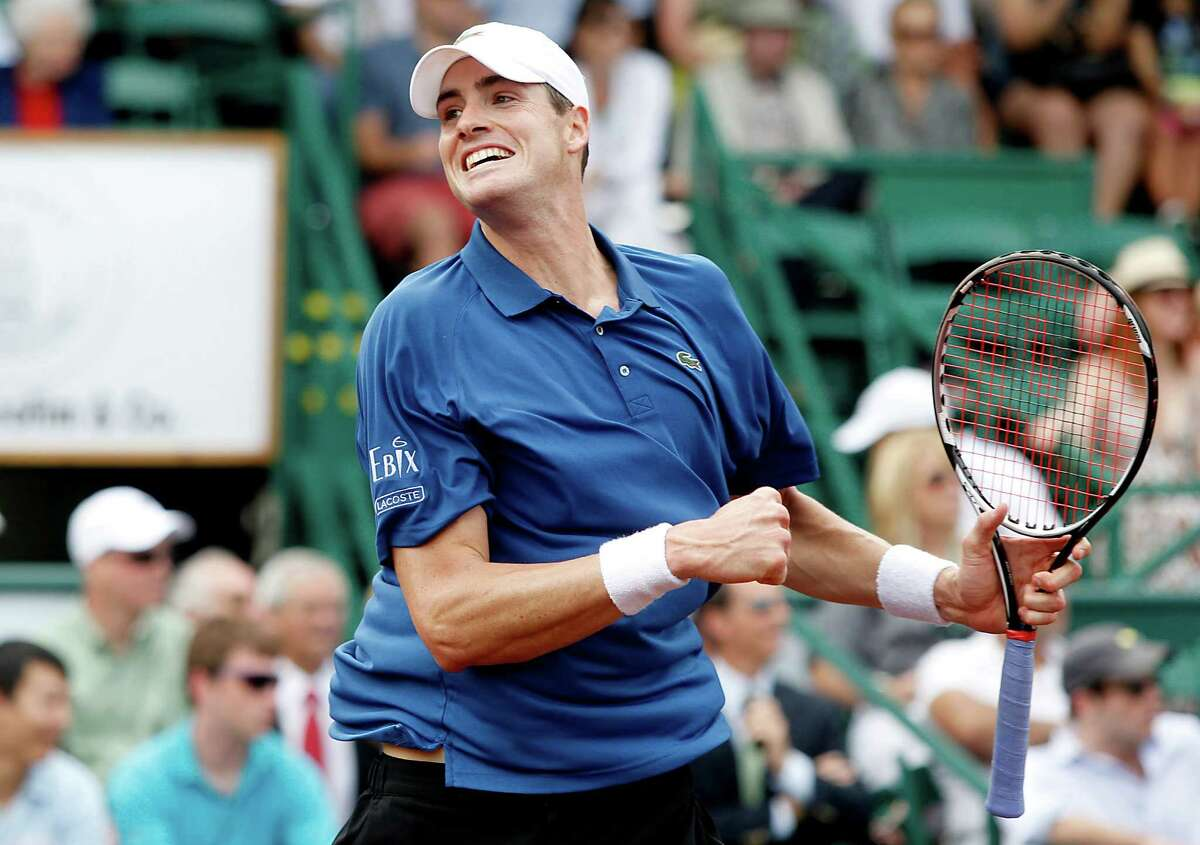 John Isner is all smiles after beating Juan Monaco and advancing to today's final against Nicolas Almagro.