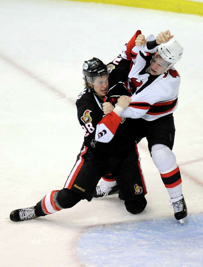 Binghamton Senators' Darren Kramer (28) and Albany Devils' Cam Janssen (14) fight during the first period of an AHL hockey game in Albany, N.Y., Saturday, April 13, 2013. (Hans Pennink / Special to the Times Union) Photo: Hans Pennink / Hans Pennink