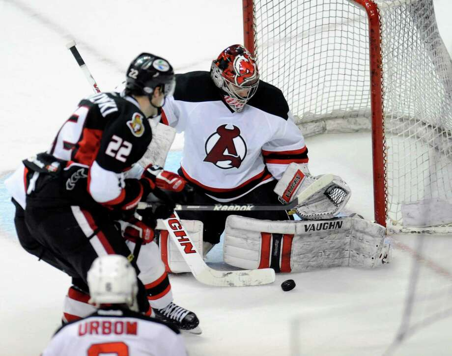 Albany Devils' Goalie Scott Wedgewood (1) stops a Binghamton Senators 