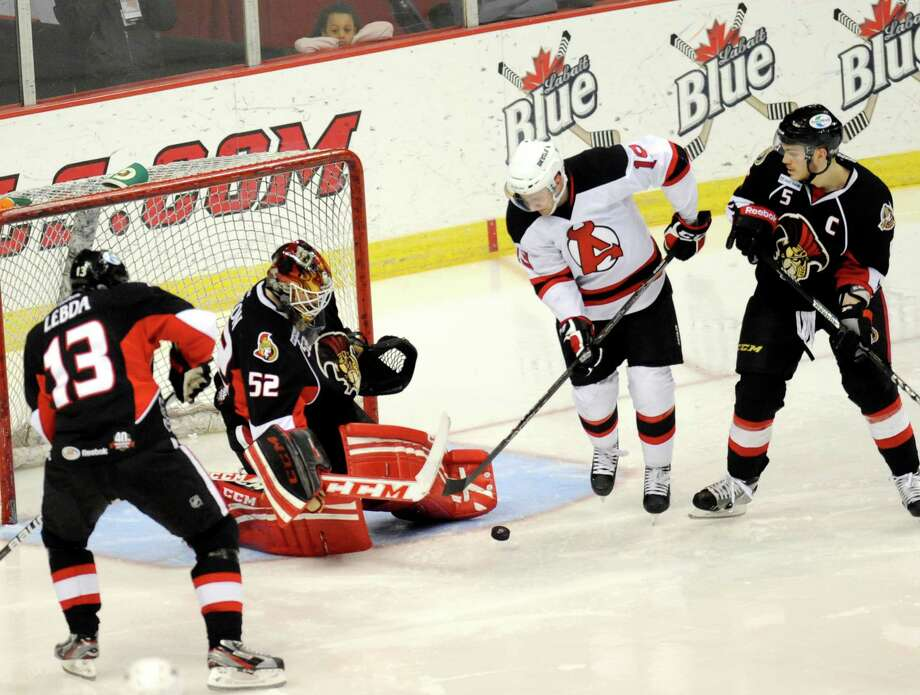 Albany Devils' Mike Sislo (19) shot on goal is blocked by Binghamton Senators' Goalie Nathan Lawson (52) during the first period of an AHL hockey game in Albany, N.Y., Saturday, April 13, 2013. (Hans Pennink / Special to the Times Union) Photo: Hans Pennink / Hans Pennink