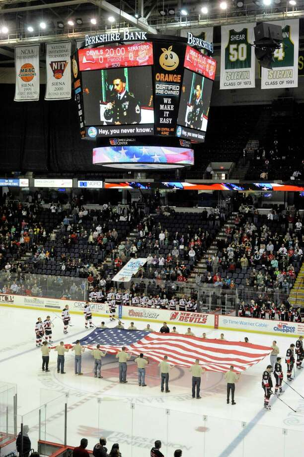 The American flag is displayed prior to the start of the Albany Devils, Binghamton Senators AHL hockey game in Albany, N.Y., Saturday, April 13, 2013. (Hans Pennink / Special to the Times Union) Photo: Hans Pennink / Hans Pennink