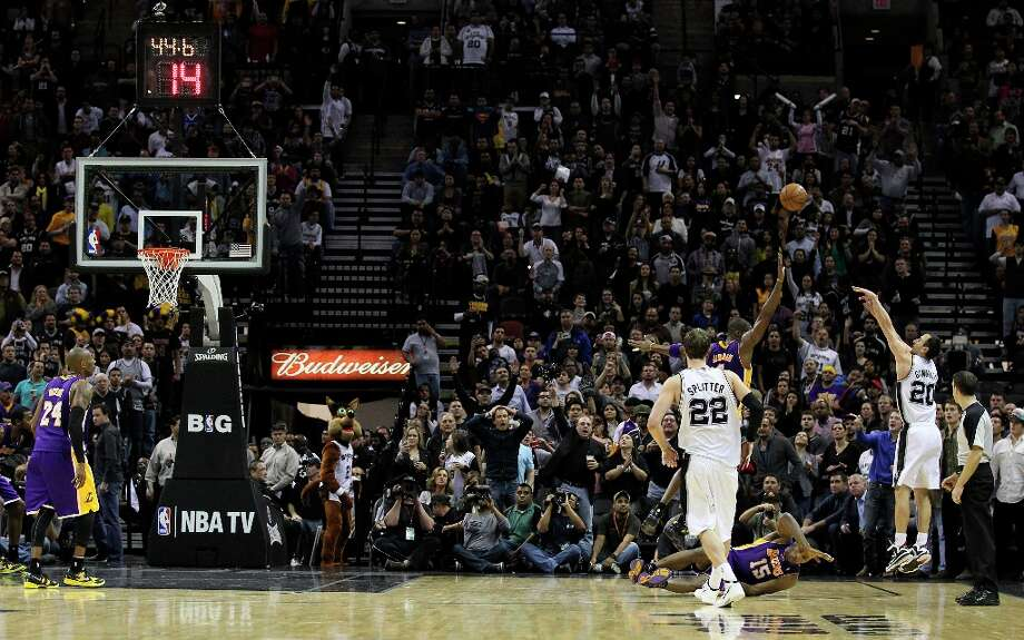 Spurs' Manu Ginobili (20) shoots a three-pointer late in the fourth over Los Angeles Lakers' Antawn Jamison (04) in the second half at the AT&T Center on Wednesday, Jan. 9, 2013. Spurs defeated the Lakers, 108-105. Photo: Kin Man Hui, San Antonio Express-News / © 2012 San Antonio Express-News