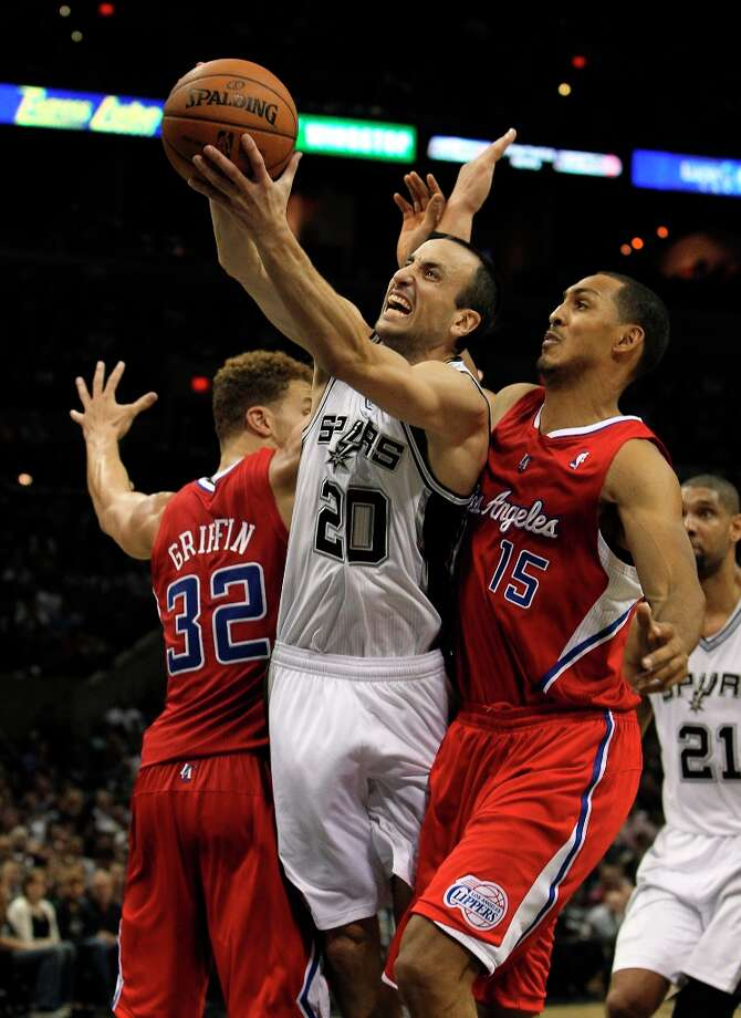Spurs' Manu Ginobili (20) attempts to score between Los Angeles Clippers' Blake Griffin (32) and Ryan Hollins (15) in the second half of their game at the AT&T Center on Monday, Nov. 19, 2012. Clippers defeated the Spurs, 92-87. Photo: Kin Man Hui, San Antonio Express-News / © 2012 San Antonio Express-News