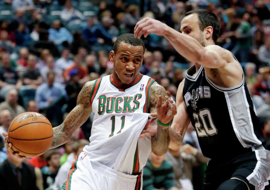 Milwaukee Bucks' Monta Ellis tries to drive past San Antonio Spurs' Manu Ginobili (20) during the first half of an NBA basketball game on Wednesday, Jan. 2, 2013, in Milwaukee. Photo: Morry Gash, Associated Press / AP