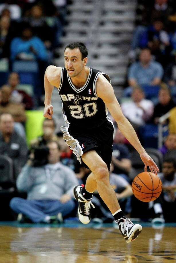 San Antonio Spurs shooting guard Manu Ginobili (20)in the first half of an NBA basketball game  in New Orleans, Monday, Jan. 7, 2013. Photo: Bill Haber, Associated Press / FR170136 AP