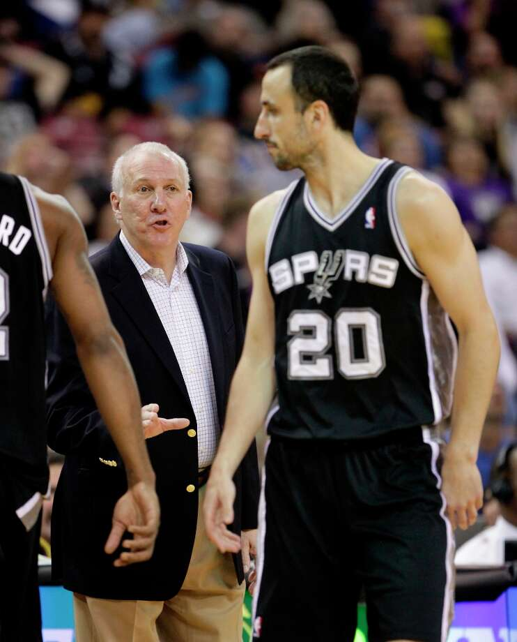 San Antonio Spurs head coach Greg Popovich, left, calls out instructions to San Antonio Spurs guard Manu Ginobili, of Argentina, during  the third quarter of an NBA basketball game against the Sacramento Kings in Sacramento, Calif., Friday, Nov. 9, 2012.  The Spurs won 97-86. Photo: Rich Pedroncelli, Associated Press / AP